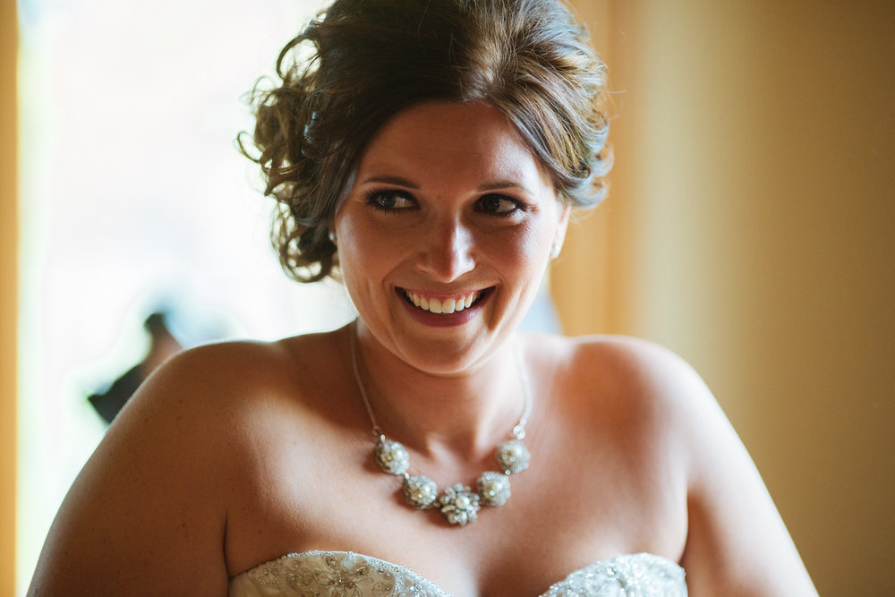 Alyssa Lee Photography | Bride getting ready, happy | Sixpence Standard Blog
