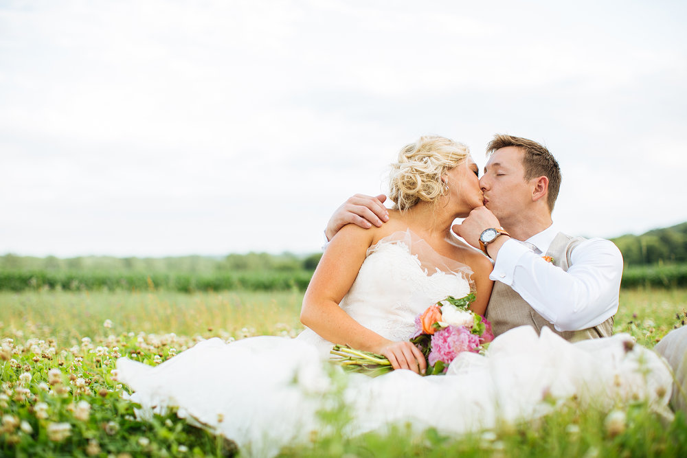 Alyssa Lee Minneapolis Wedding Photographer | Sixpence Standard wedding blog | bride and groom kissing in a field of clover