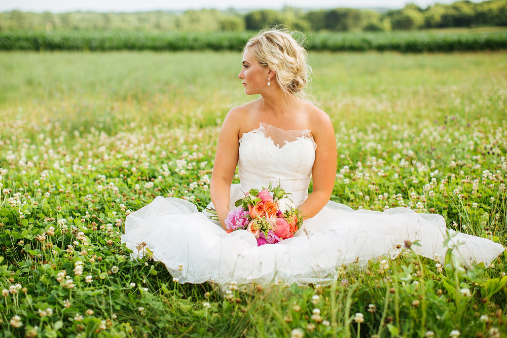 Alyssa Lee Minneapolis Wedding Photographer | Sixpence Standard wedding blog | bride in a field of clover