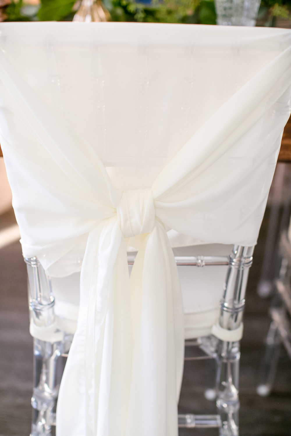 Jeannine Marie Photography | We've Got it Covered | Bel Fiore | Sixpence Events & Planning table styling for wedding, harvest table with gold chargers and navy napkins | clear chiavari chair white sash knot