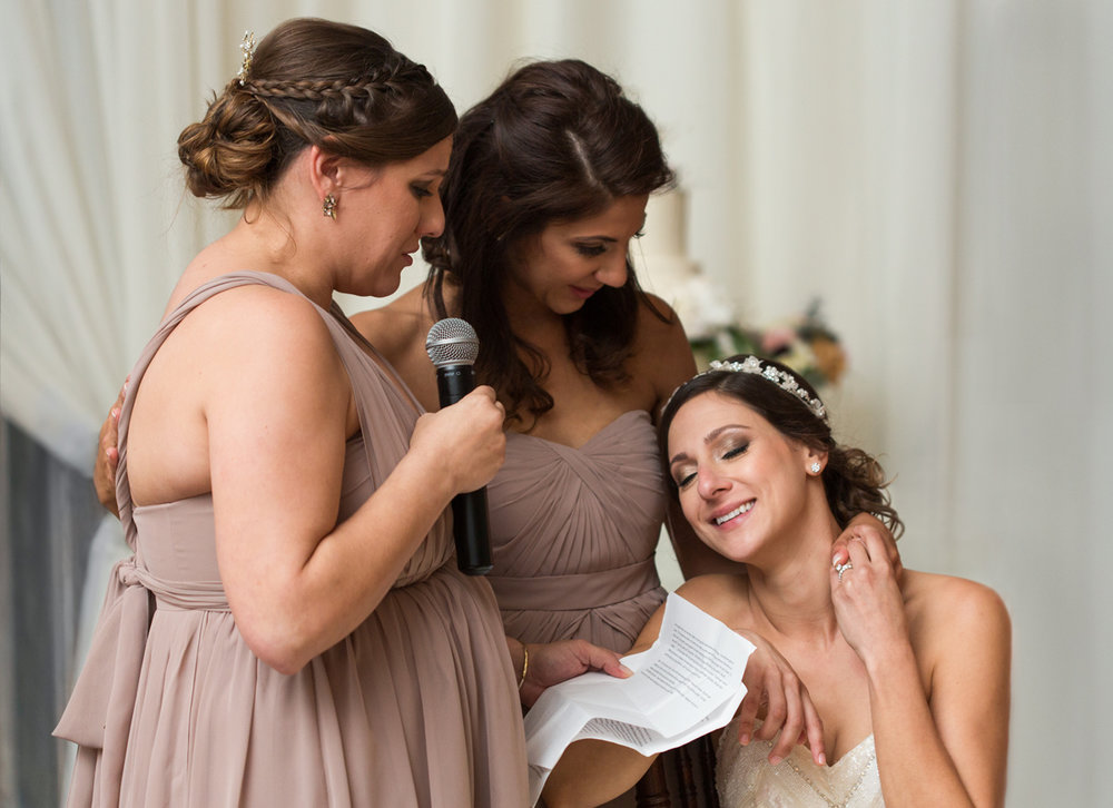 Sarah Jane wedding photographer, bridesmaids speech to a bride with a white beaded floral crown
