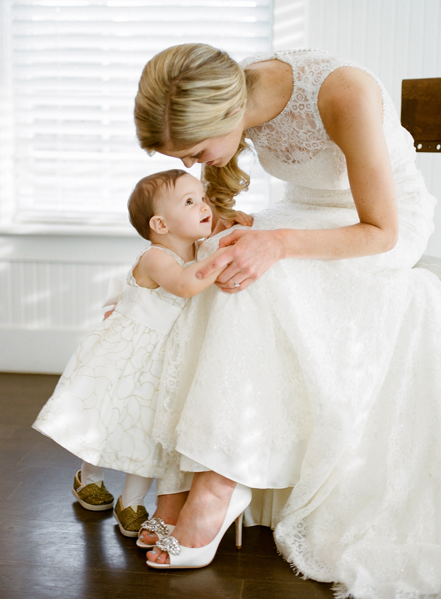 Sarah Jane wedding photographer | Bride and her flower girl precious moment | peep toe heels | Sixpence Standard wedding blog