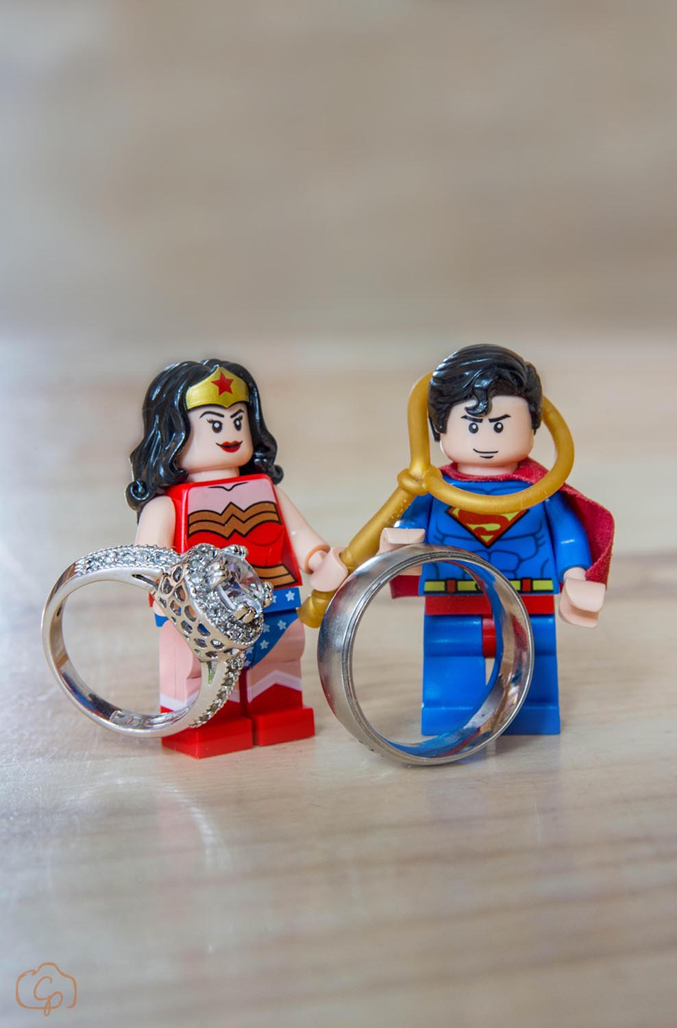 Lego Super heroes holding the wedding rings | Coppersmith Photography | ring detail shots