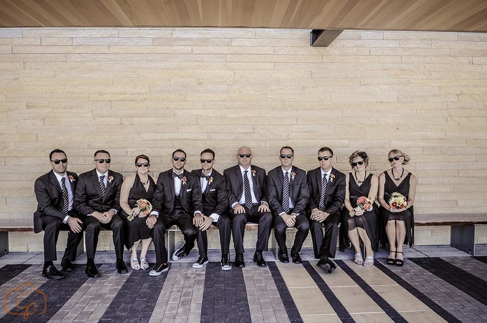 Serious bridal party photo sitting down, grooms | Wedding blog by Sixpence Events & Planning | Coppersmith Photography, Minnesota Wedding Photographer