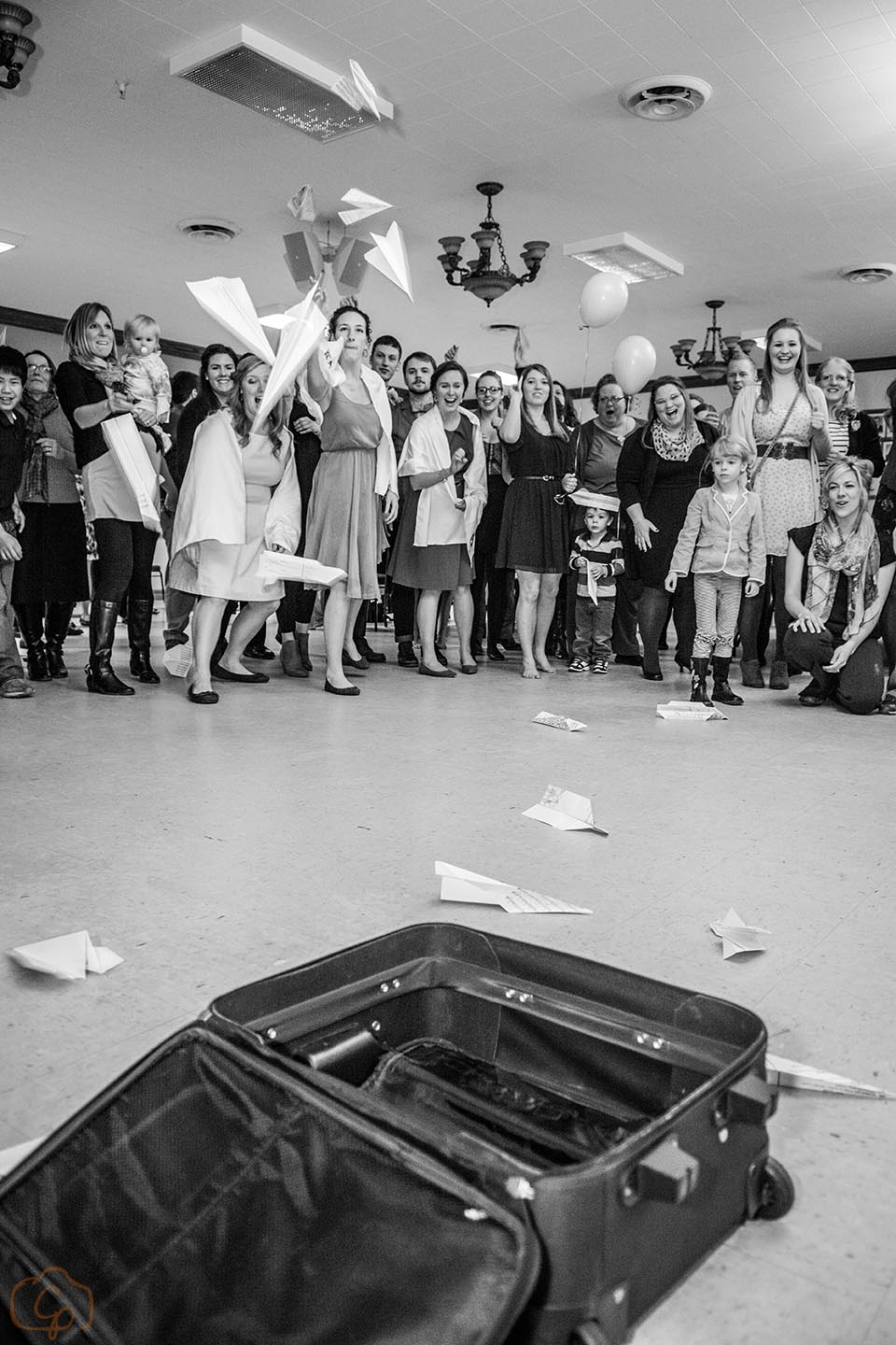 Nontraditional wedding rituals for the reception | Coppersmith Photography | paper airplane toss into suitcase