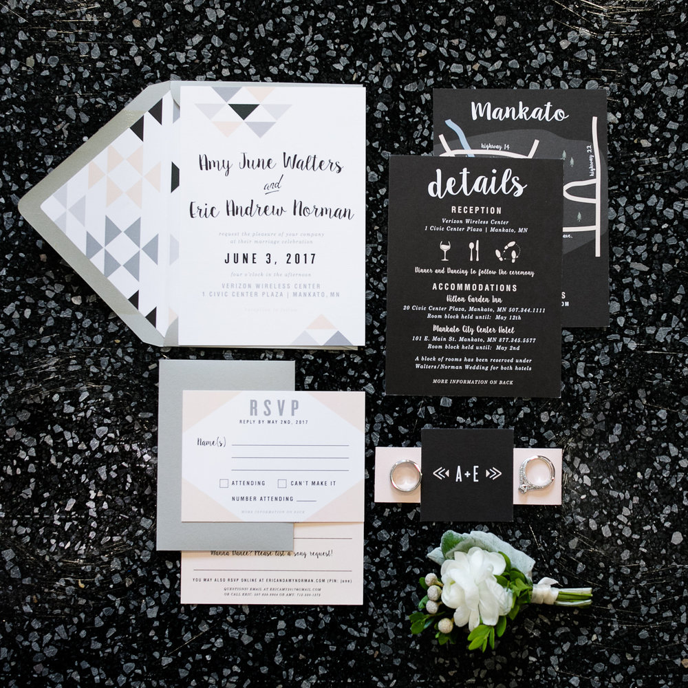 Invitation suite on a black backdrop | geometric envelope liner | boutonniere in the flat lay | Alice HQ Wedding Photographer