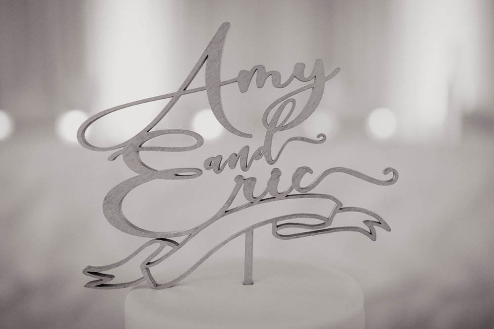 Amy + Eric laser cut cake topper in silver with banner below | Alice HQ wedding photographer