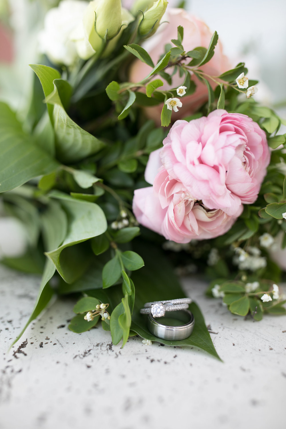 Budding Creations wedding bouquet | wedding rings | round diamond | pink ranunculus and lisianthus | Sixpence Events