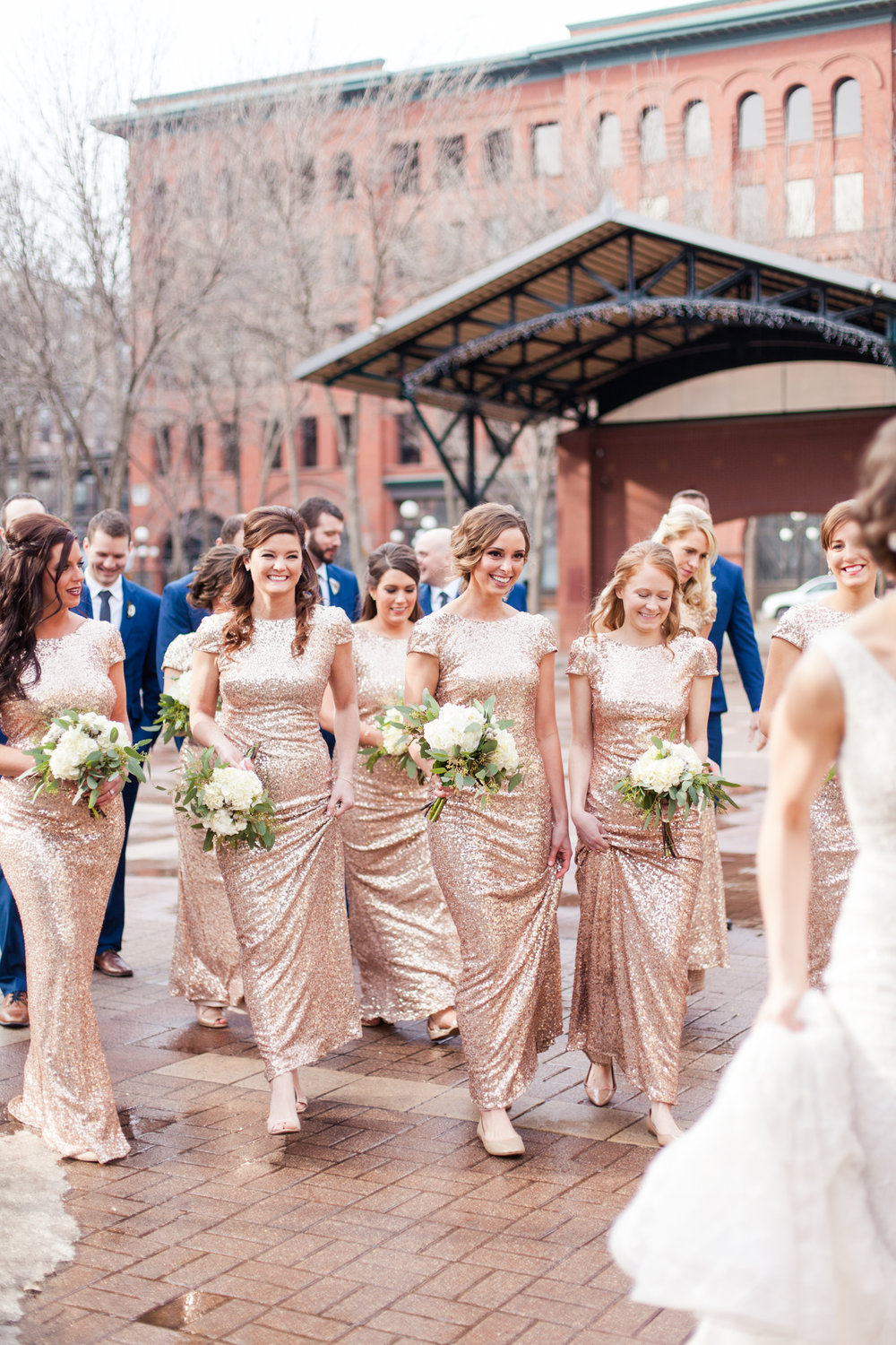 blush bridesmaids dresses with sleeves and a scoop back | succulent and white bouquets | nude flats | navy groomsmen  | Sixpence Events & Planning | Jessa Anderson Photography | winter wedding | Mears Park in St Paul, Minnesota