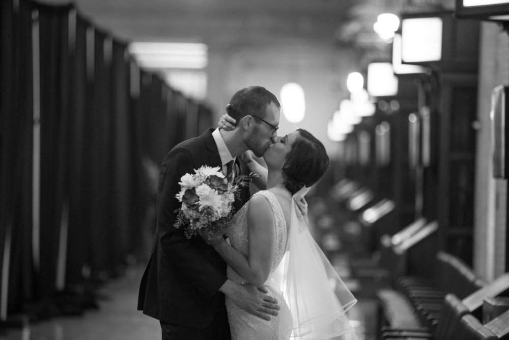 post-ceremony kiss in the hall  | Sixpence Events & Planning | Jessa Anderson Photography | winter wedding