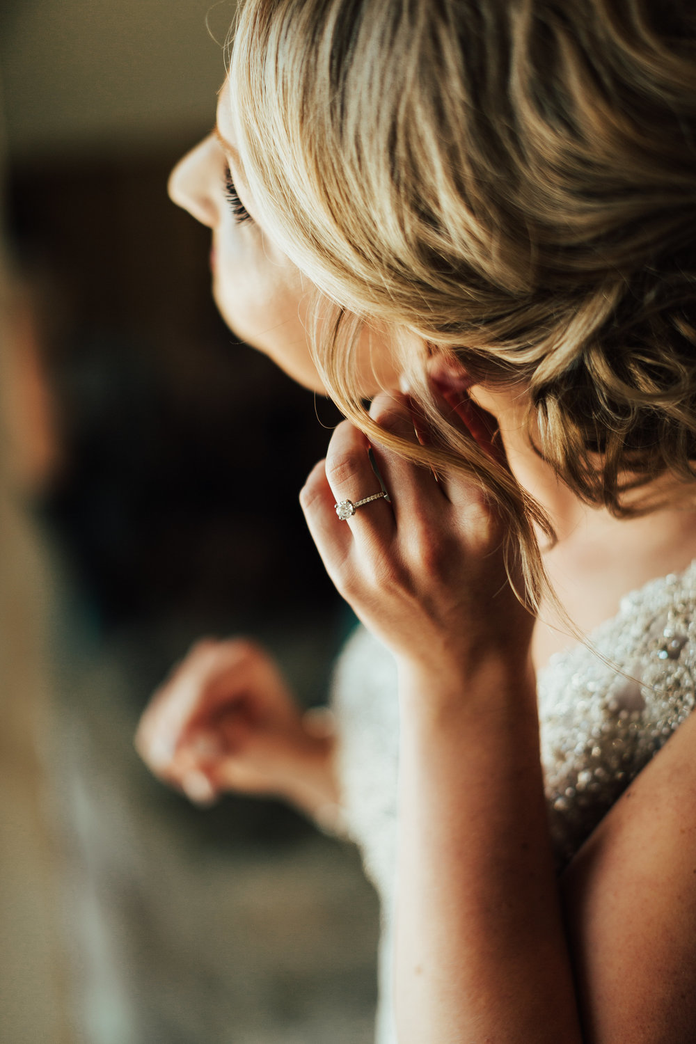bride putting on earrings detail picture | Janelle Elise | Megan + Corey | Furber Farm | Sixpence Events | A Vintage Touch Weddings56.jpg