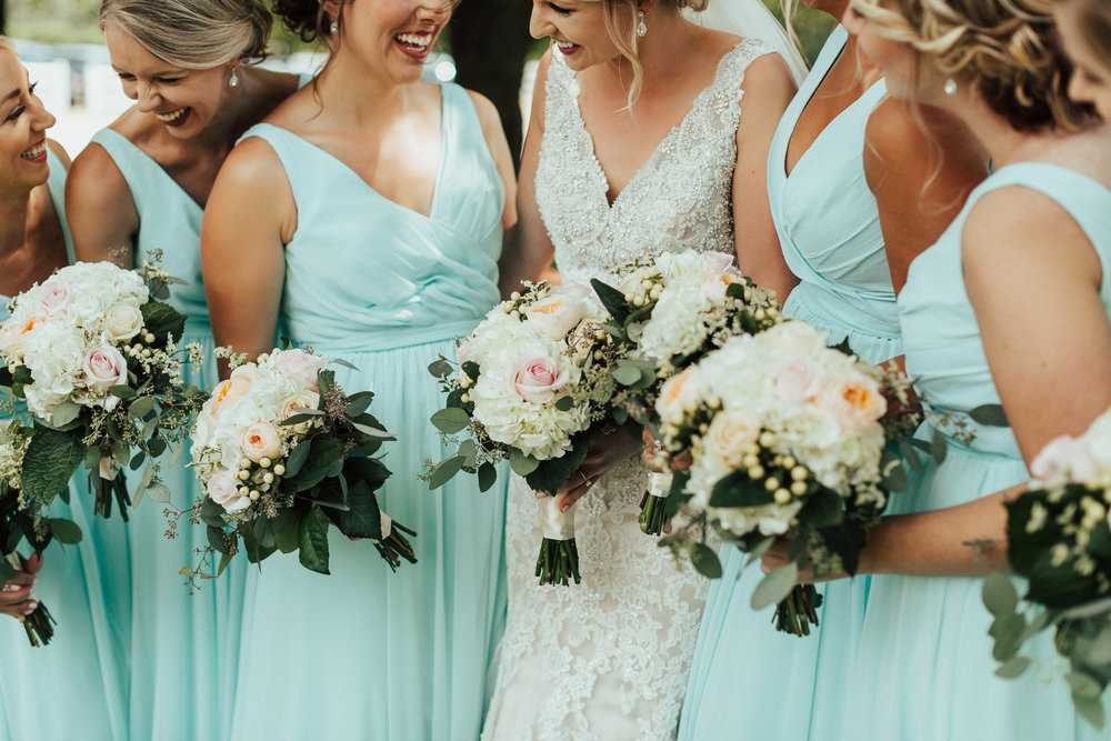 mint green v neck bridesmaids | bride in sequinec dress with tear drop earrings | bouquets with hypericum berries and garden roses | Janelle Elise | Megan + Corey | Furber Farm | Sixpence Events | A Vintage Touch Weddings89.jpg