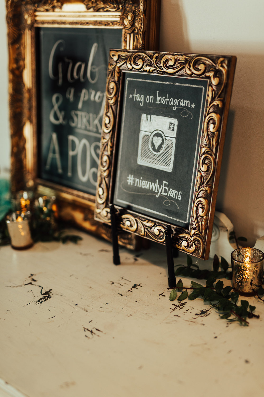 photo booth sign | grab a prop and strike a pose | hashtag sign on chalkboard gold frame | Janelle Elise | Megan + Corey | Furber Farm | Sixpence Events | A Vintage Touch Weddings