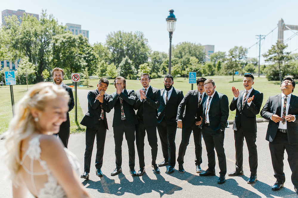 first look with the groomsmen | Aaron T Photography | Nicolett Island | Sixpence Events and Planning day of coordinating and wedding blog
