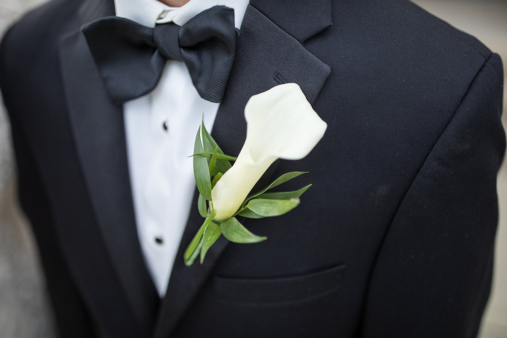 groom with white orchid as a boutonniere with italian ruscus and a black bowtie with button caps | Brian Bossany Photography | Sixpence Events & Planning wedding blog and day of coordinating