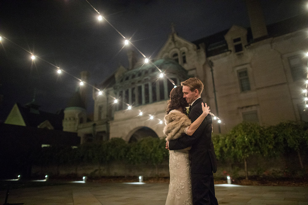 private first dance in the American Swedish Institute courtyard with cafe lights  | Brian Bossany Photography | Sixpence Events & Planning wedding blog and day of coordinating