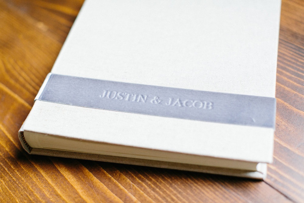 Carly Milbrath Photography | Justin and Jacob | PAIKKA Minnesota Wedding Venue | Same sex wedding with two grooms | guest picture book with felt ribbon strip with name engraved
