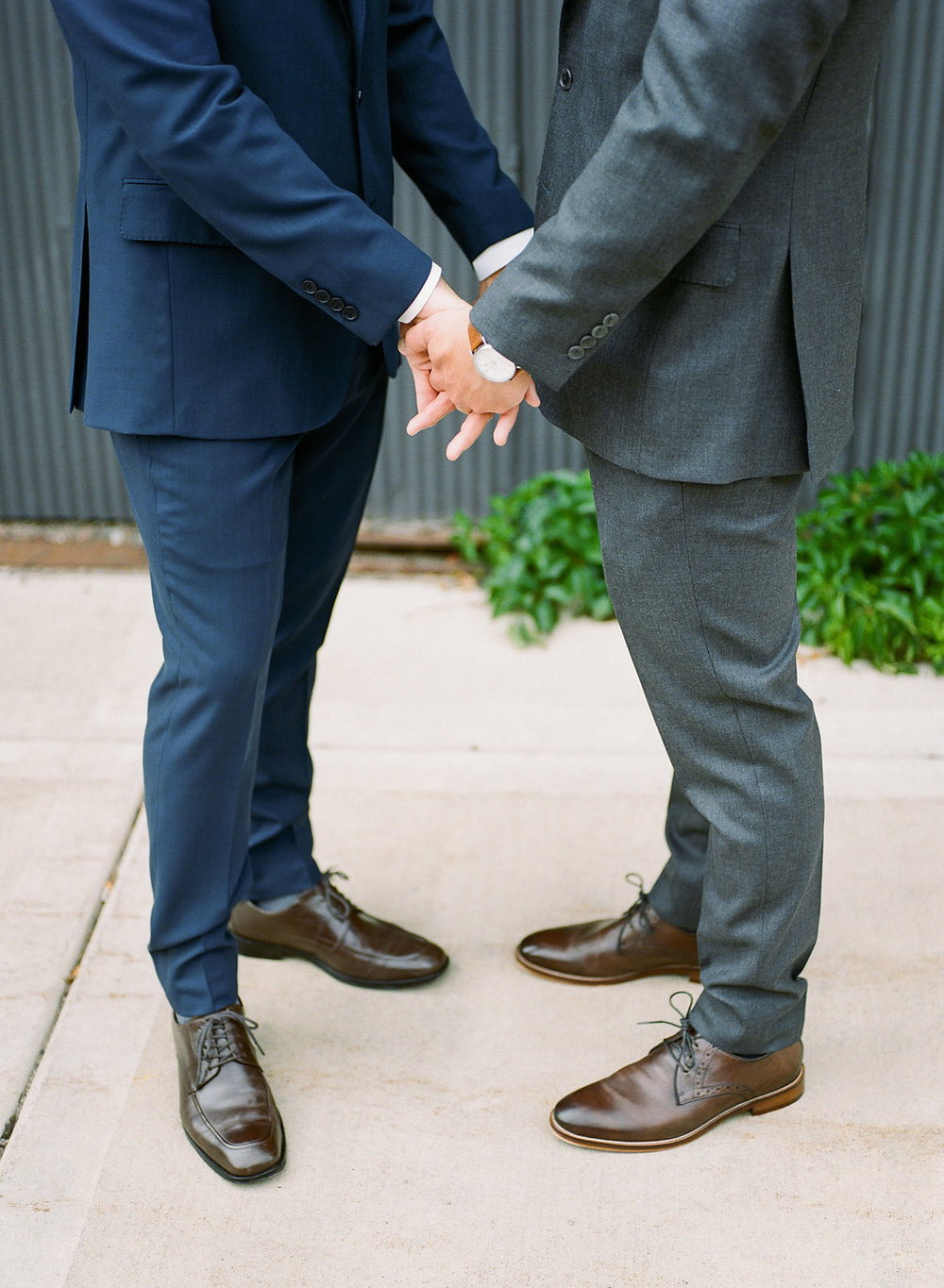 Carly Milbrath Photography | Justin and Jacob | PAIKKA Minnesota Wedding Venue | Same sex wedding with two grooms hand holding photo