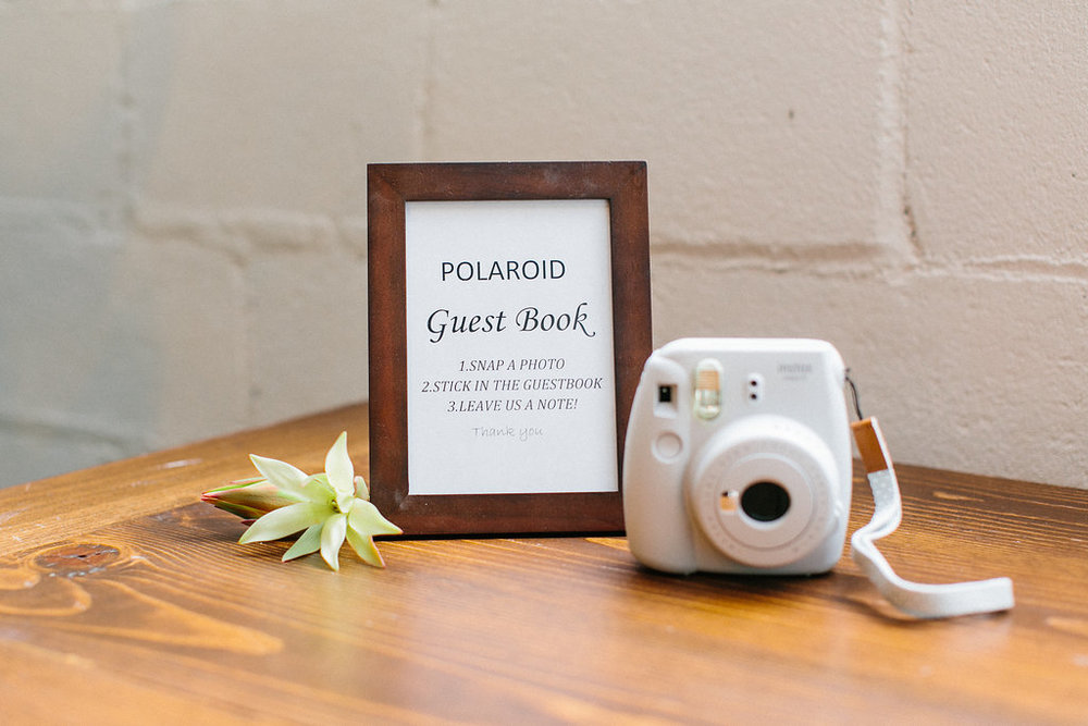 Carly Milbrath Photography | Justin and Jacob | PAIKKA Minnesota Wedding Venue | polaroid guest book sign