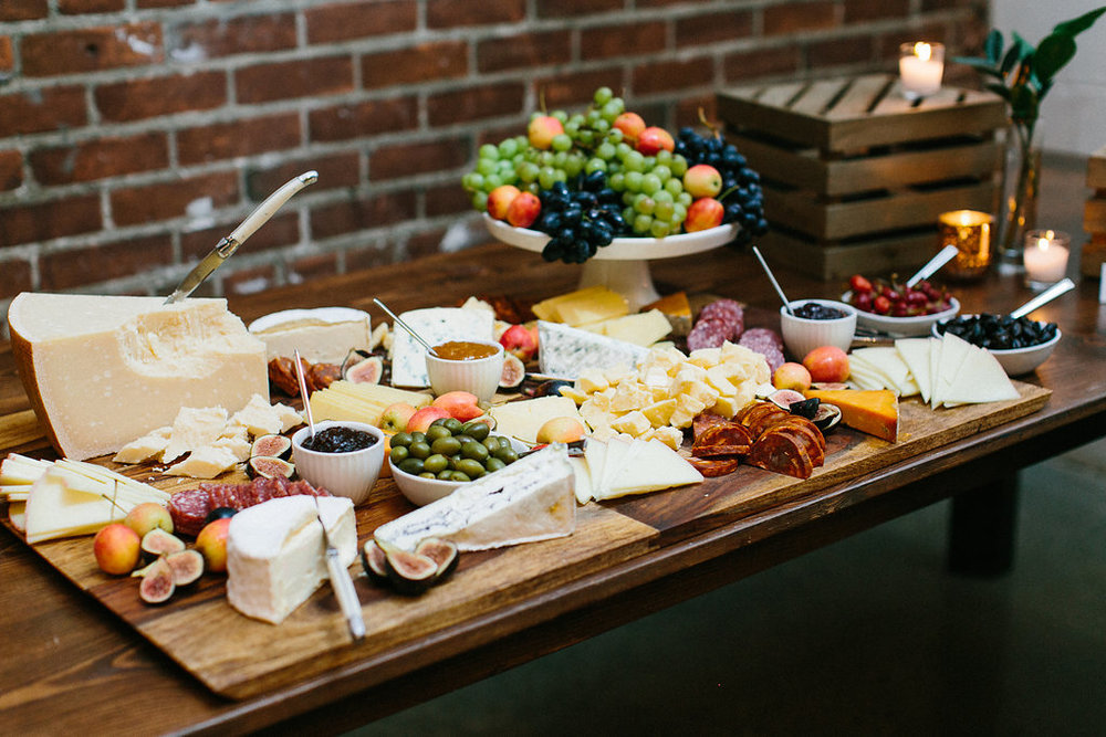 Carly Milbrath Photography | Justin and Jacob | PAIKKA Minnesota Wedding Venue | wedding charcuterie spread with cheese blocks for heavy apps wedding dinner