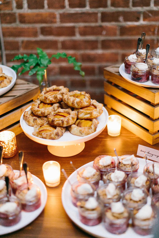Carly Milbrath Photography | Justin and Jacob | PAIKKA Minnesota Wedding Venue | mini desserts wedding spread