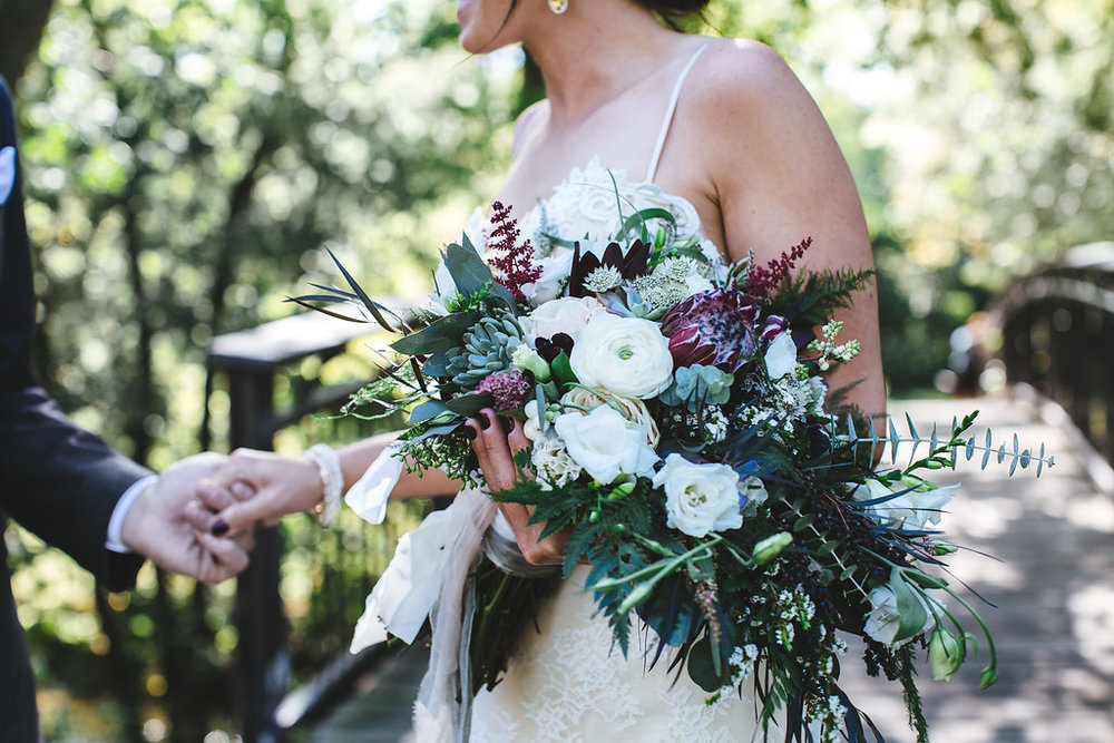 Minnehaha Creek Park | bridal bouquet with lisianthus, eucalyptus, astilbe, protea and roses