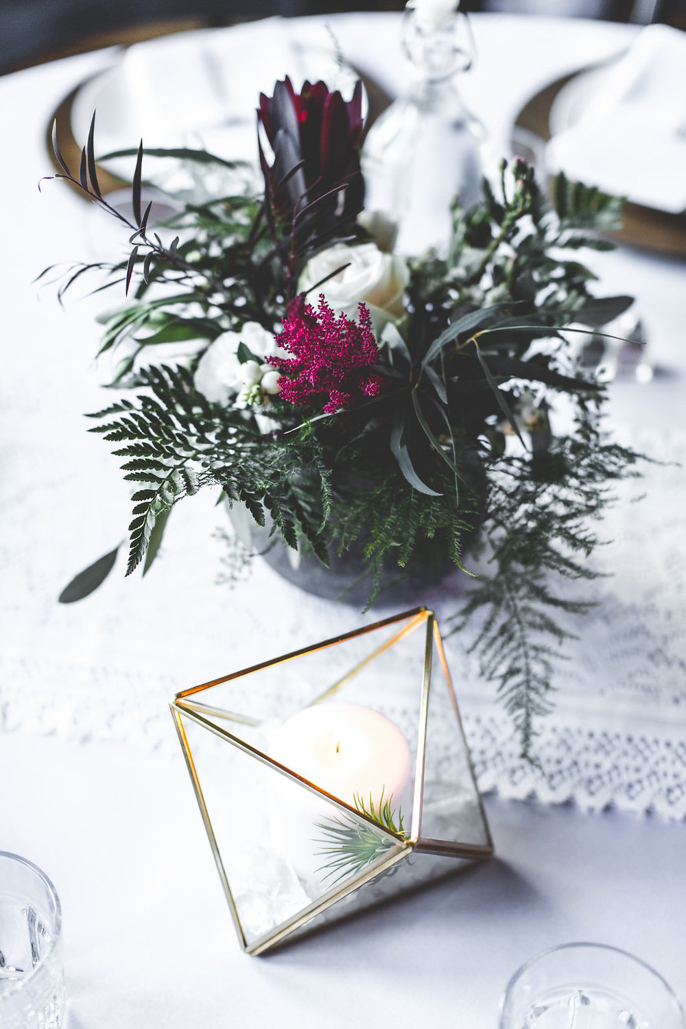 geo candle holder with air plant | concrete plant holders with ferns | diy wedding decor | wood chargers | Aaron Rice Photography | Sixpence Events day of coordinating