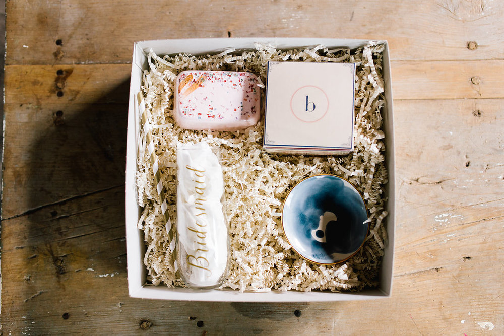 Jade + Seth Wedding | Allison Hopperstad Photography | Bloom Lake Barn | Jade Taylor Market custom bridesmaid gift box with bridesmaid champagne flute and watercolor ring dish | Sixpence Events & Planning day of coordinating