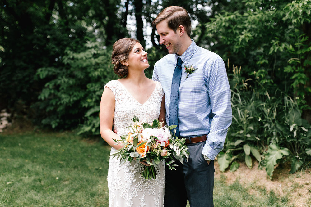 Jade + Seth Wedding | Allison Hopperstad Photography | Bloom Lake Barn | Day of coordinating by Sixpence Events & Planning | bright bouquet by Lakeside floral | groom without a suit jacket | groom in blue shirt with blu tie, boutonniere pinned to shirt with gray slacks