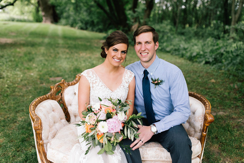 Jade + Seth Wedding | Allison Hopperstad Photography | Bloom Lake Barn | A Vintage Touch rentals settee vintage couch | bridal portraits | gorgeous makeup and hair bridal bombshell | bright colored bouquet with orange and pink