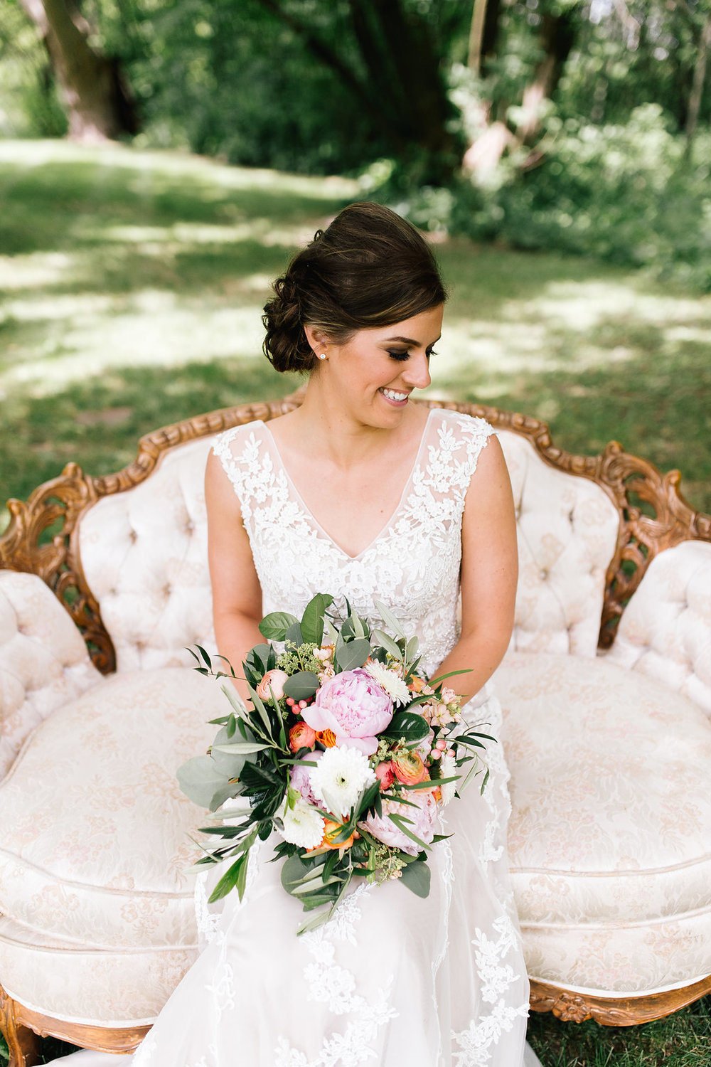 Jade + Seth Wedding | Allison Hopperstad Photography | Bloom Lake Barn | bridal portrait on vintage couch - A Vintage Touch Weddings | bridal dress with v neck lace no sleeves
