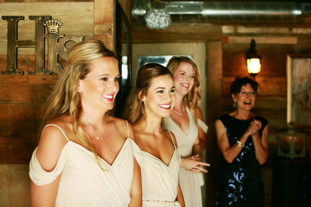 Jenna Kevin Wedding | Sixpence Events day of coordinating | Hannah Schmitt Photography | Legacy Hill Farm | bridesmaids first look with bride | off the shoulder drape dress