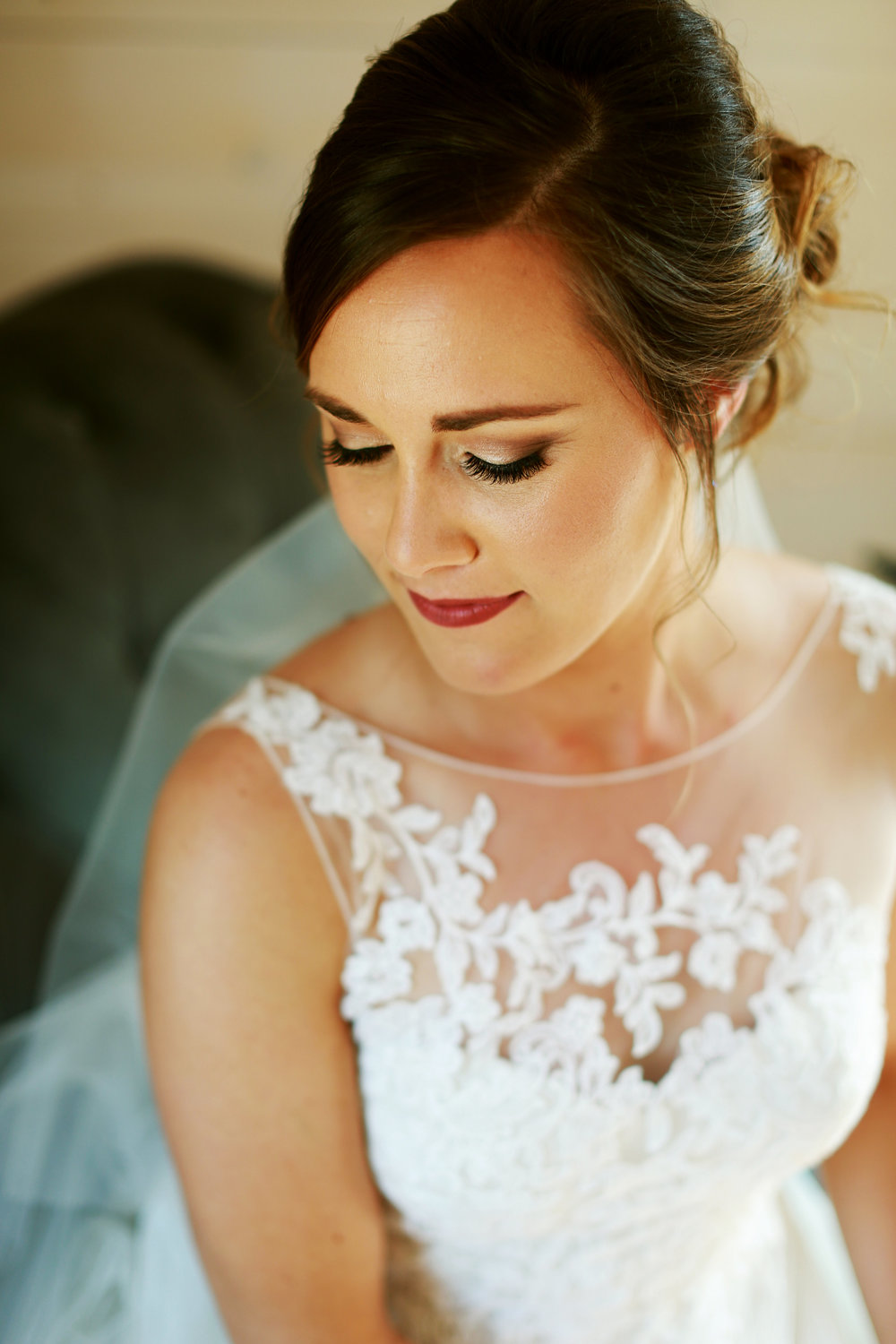 Jenna Kevin Wedding | Sixpence Events day of coordinating | Hannah Schmitt Photography | Legacy Hill Farm | bridal beauty shot | lace sheer top with low bun and perfect gold smoky eye