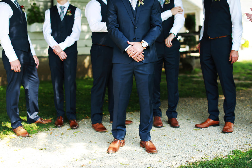 Jenna Kevin Wedding | Sixpence Events day of coordinating | Hannah Schmitt Photography | Legacy Hill Farm | groomsmen with navy vests and striped ties and brown shoes