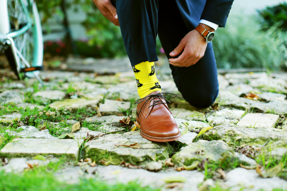 Jenna Kevin Wedding | Sixpence Events day of coordinating | Hannah Schmitt Photography | Legacy Hill Farm | groom with yellow batman socks and brown accessories