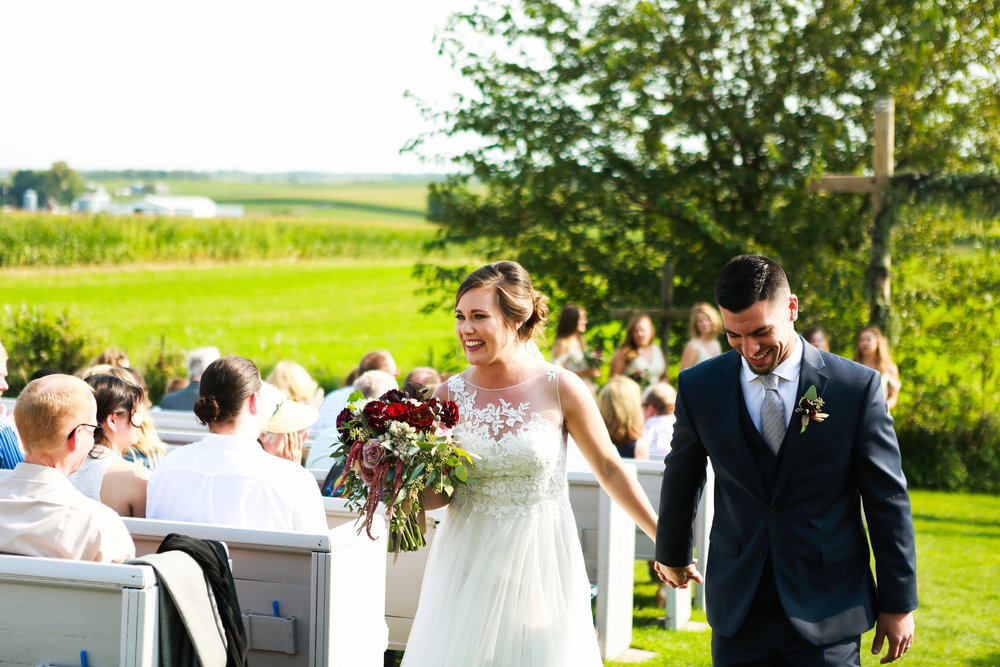 Jenna Kevin Wedding | Sixpence Events day of coordinating | Hannah Schmitt Photography | Legacy Hill Farm | just married recessional