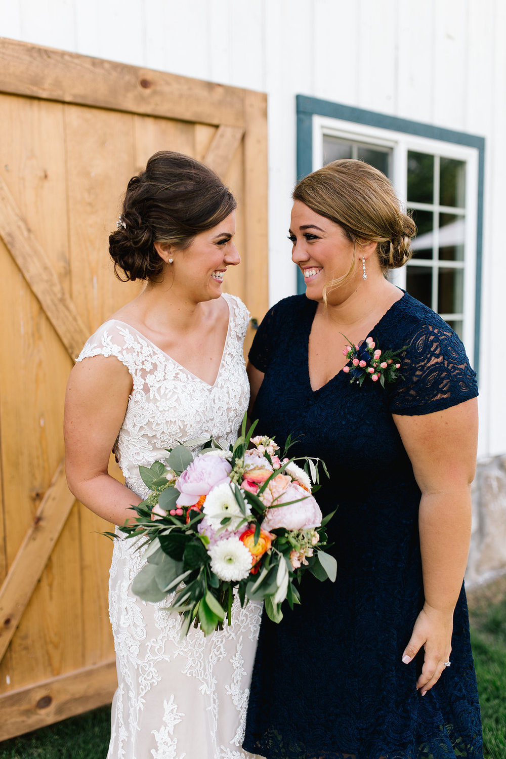 Jade and Seth Bloom Lake Barn wedding | Allison Hopperstad Photography | A Vintage Touch Weddings planning nad design | Day of Coordinating by Sixpence Events | best personal attendant | navy lace dress for personal attendant | pin corsage for personal attendant
