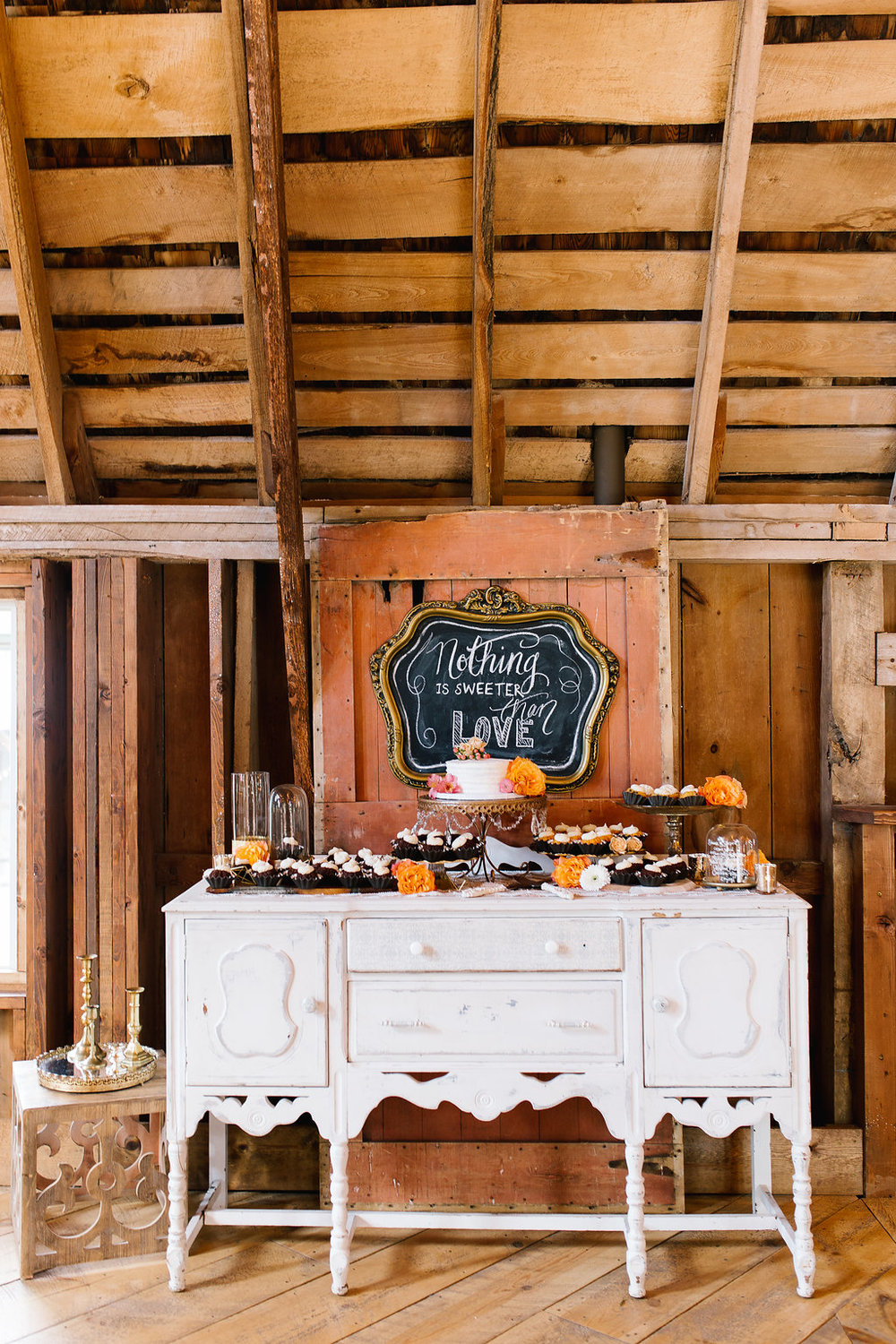 Jade and Seth Bloom Lake Barn wedding | Allison Hopperstad Photography | A Vintage Touch Weddings planning nad design | Day of Coordinating by Sixpence Events | nothing is sweeter than love sign on old barn door and chalkboard | bunt cake buffet