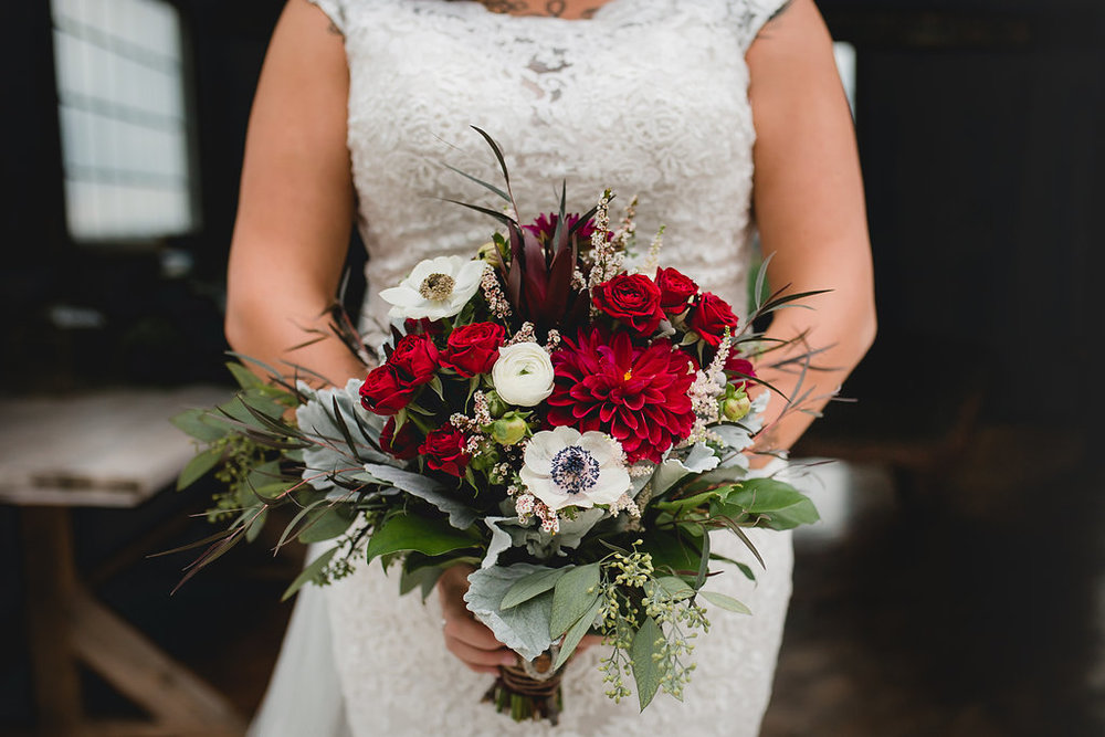 Leslee & Billy | Legacy Hill Farm Wedding | Aqua Fox Photography | A Vintage Touch Wedding Planning | Sixpence Events & Planning day of coordinating | Cutting garden bridal bouquet with dusty miller, wax flowers, anemone, ranunculus, roses and dahlias wit h seeded eucalyptus