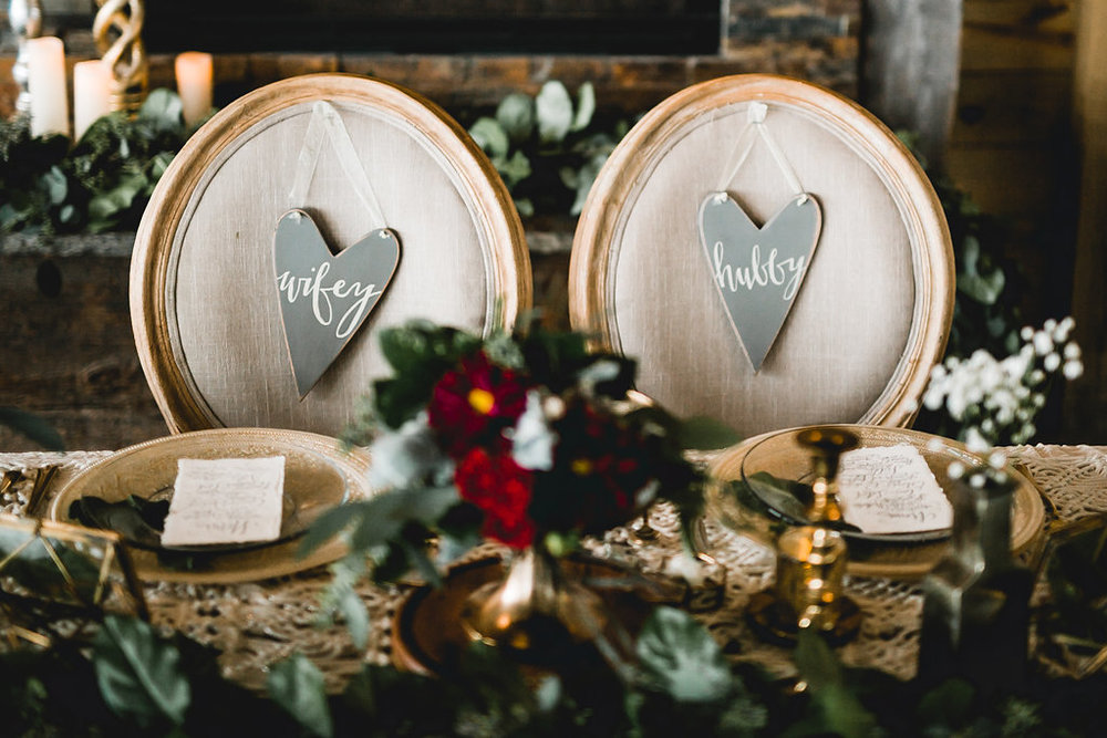 Leslee + Billy | Aqua Fox Photography | Legacy Hill Farm | A Vintage Touch design | wifey and hubby grey wood hearts on padded head table chairs