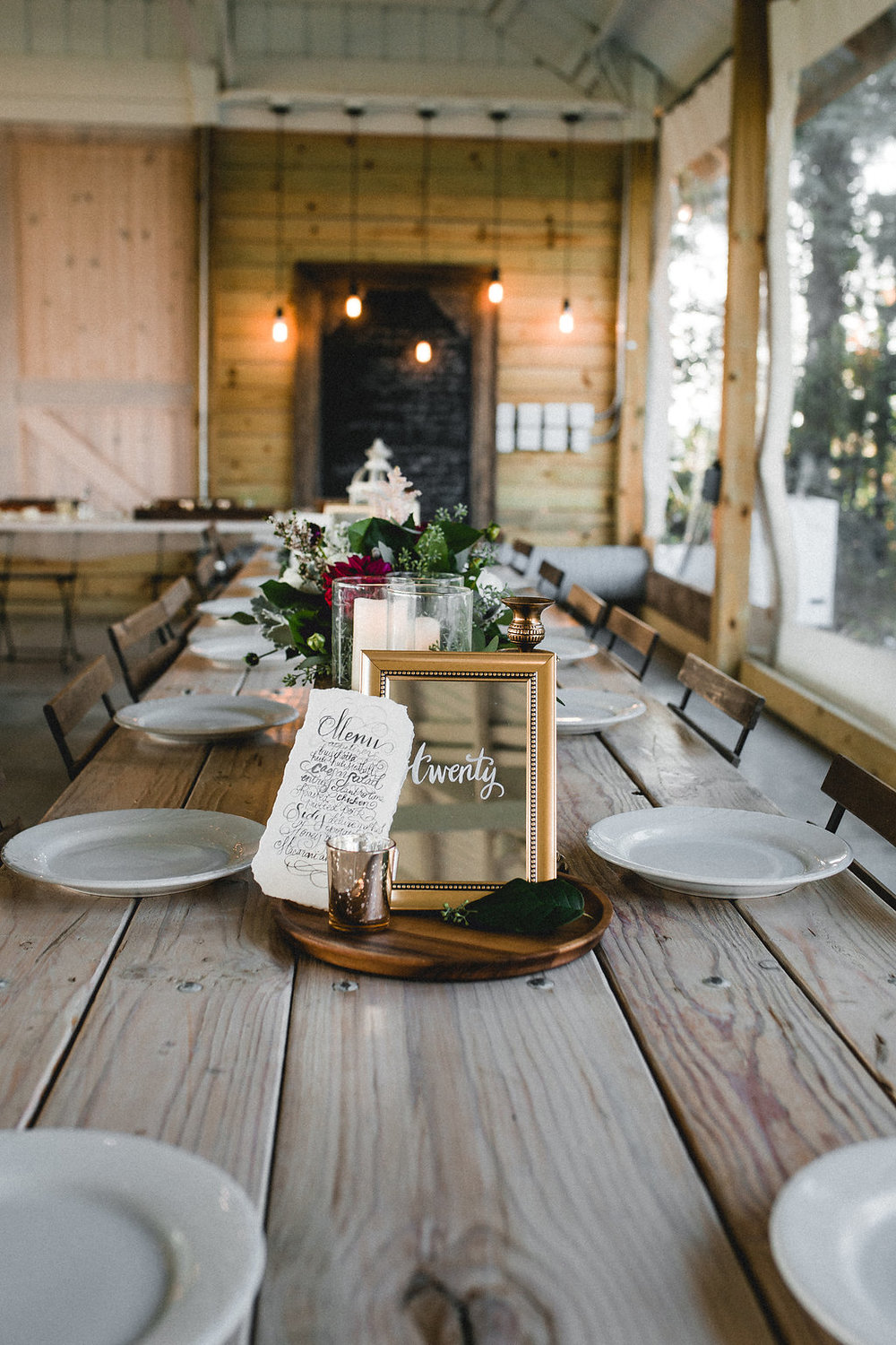 Leslee + Billy | Aqua Fox Photography | Legacy Hill Farm |  A Vintage Touch Weddings table design on bare tables with mirror table numbers and hand calligraphy menus | NO charger