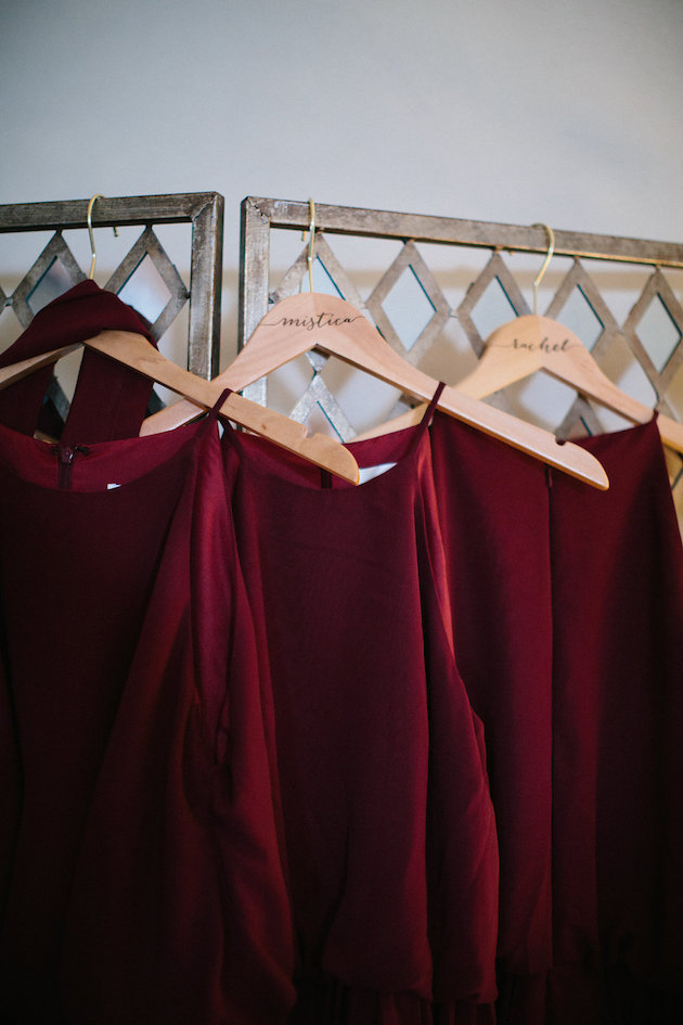 Nicole + Luke | Villa Bellezza | Kristina Lorraine Photo | Bill Levkoff bridesmaid dresses on wood hangers with personalized names