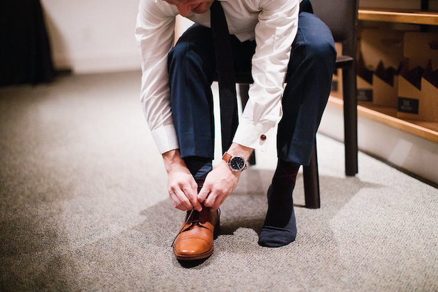 Nicole + Luke | Villa Bellezza | Kristina Lorraine Photo | groom putting his shoes on