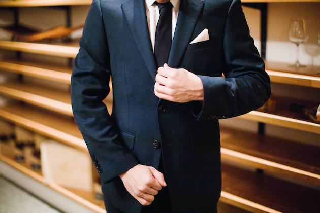 Nicole + Luke | Villa Bellezza | Kristina Lorraine Photo | groom in a dark navy suit with dark tie and white pocket square