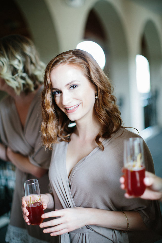 Nicole + Luke | Villa Bellezza | Kristina Lorraine Photo | matching bridesmaids robes with stemless champagne flutes