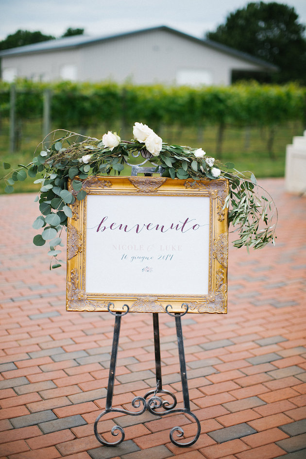 benvenuto welcome sign in gold ornate frame with greenery | Nicole + Luke | Villa Bellezza | Kristina Lorraine Photo31.jpg