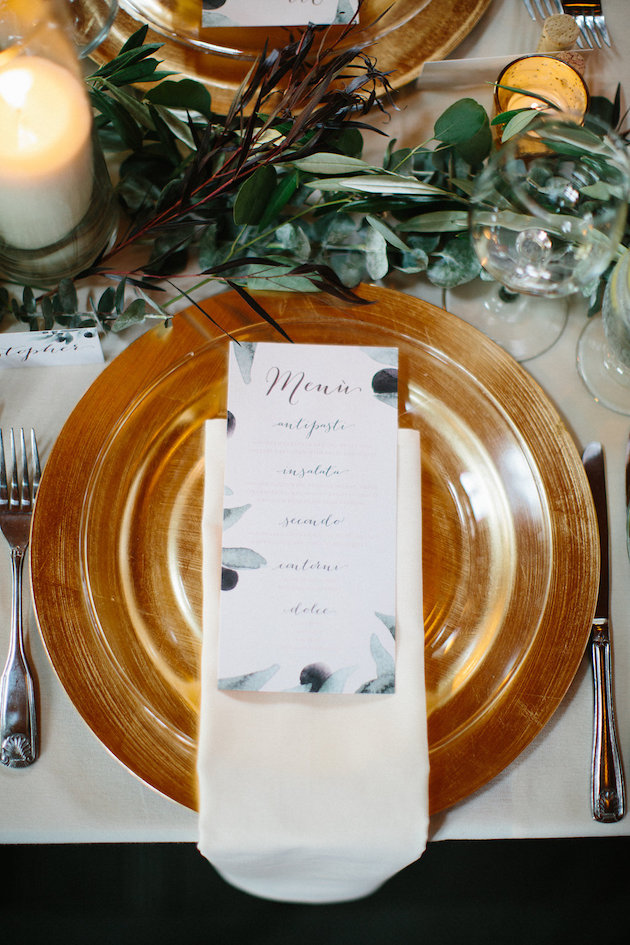 gold charger with ivory napkin and clear plate with menu on top | Nicole + Luke | Villa Bellezza | Kristina Lorraine Photo39.jpg