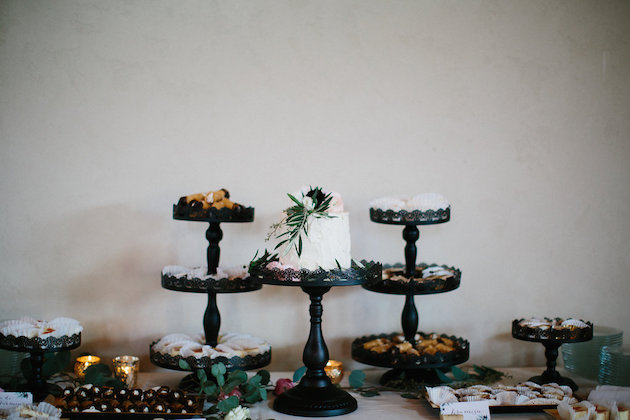 Amy's Cupcake Shoppe one tiered cake on three tiered black cake stands  | Nicole + Luke | Villa Bellezza | Kristina Lorraine Photo43.jpg