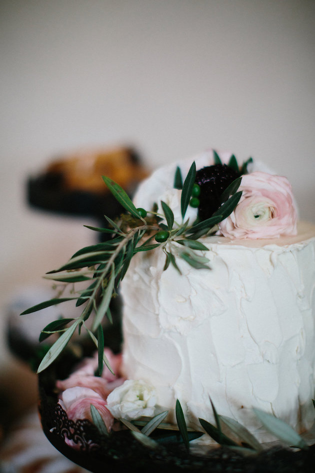 Amy's Cupcake Shoppe cake with pink ranunculus and rosemary on top | Nicole + Luke | Villa Bellezza | Kristina Lorraine Photo44.jpg