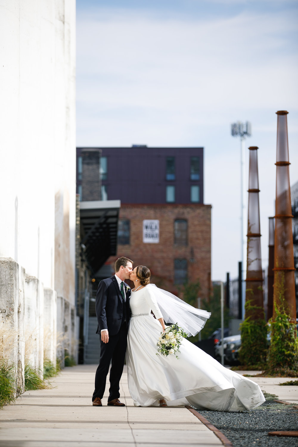 Brovado Wedding Photography | Machine Shop Minneapolis | Sixpence Events Day of Coordinating | bride and groom city kiss.jpg